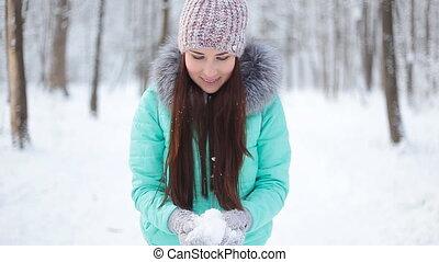 Girl throws snow