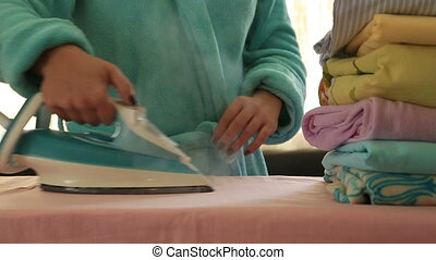 Woman ironing clothes - Depressed, tired housewife ironing...