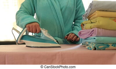 Depressed, tired housewife ironing - Woman Annoyed To Be...