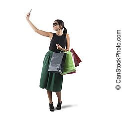 Selfie shopping - Girl gets a selfie with her purchases