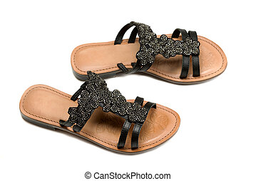 A pair of leather women's sandals. Top view from the side....