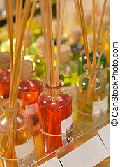 Aroma therapy - Some fragrance in small glass bottle with...