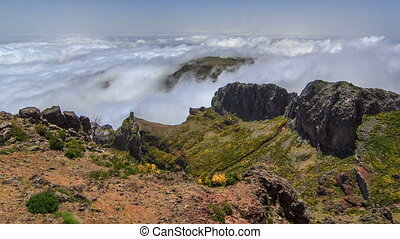 View down over the clouds from slopes of Pico do Arieiro,...