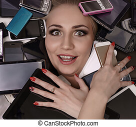 Digital madness. Stunned girl with smartphones - Digital...