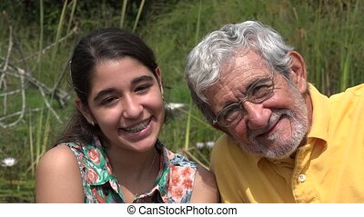 Grandfather and Granddaughter Outdoors