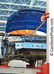 reparation of car body on building berth - car body on a...