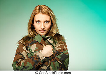 Beautiful woman in military clothes portrait