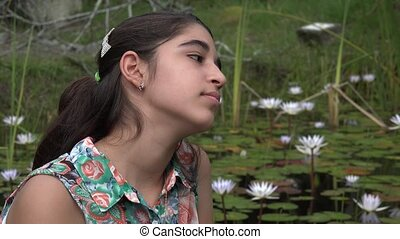 Girl Daydreaming at Pond