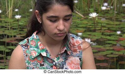 Sad Teenage Girl near Pond