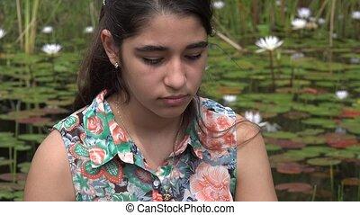 Sad Teenage Girl near Pond