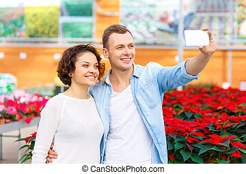 Young couple taking selfies at orangery - Selfie time Young...
