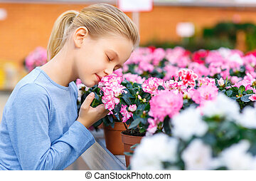 Little girl inhaling flower scent - Sniff up the scent...