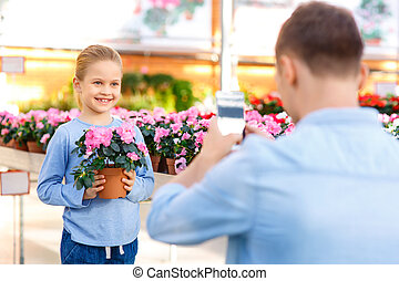 Little girl posing with flower. - Snapshot to remember....