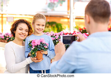 Daughter and mother are posing for pictures. - Family...