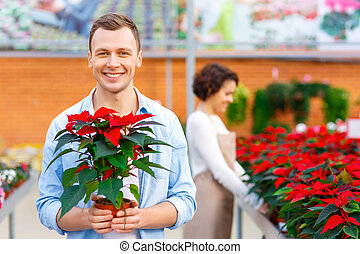 Delighted customer holding a flower. - Successful purchase....