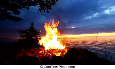 Great Lakes Beach Campfire - Sunset camp fire along a...