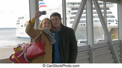 Happy couple making selfie with phone in harbor - Happy...