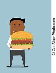 Businessman with large appetizing hamburger