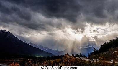 Sun Breaking through Dark Clouds