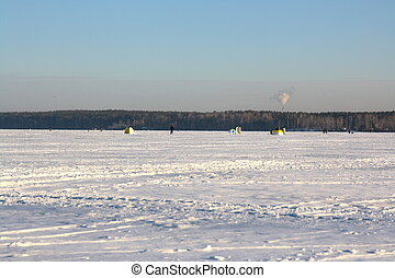 Fishermans on ice for fishing with equipments