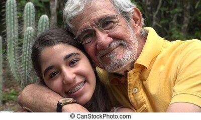 Grandfather and Granddaughter with Cactus