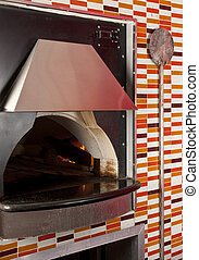 The oven - View of commercial oven in a pizza parlor...