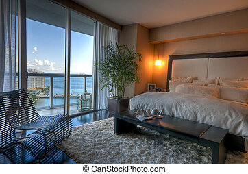 Luxury Bedroom - View of luxury apartment bedroom with view...
