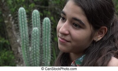 Happy Young Teenage Girl and Cactus