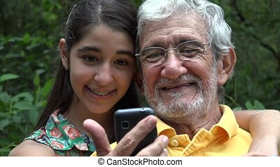 Grandfather and Granddaughter Selfy - Grandfather and...