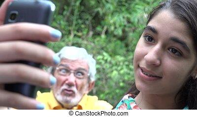 Teenage Girl Selfie Photobombed - Teenage Girl Taking Selfie...