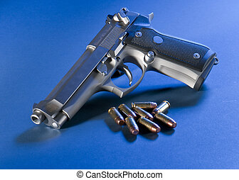 Patriotic Pistol - Close up view of bullets and automatic...