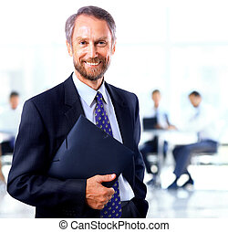 adult man smiling looking at the camera with a folder in his...