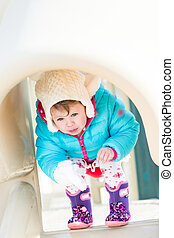 Baby girl playing on outdoor playground