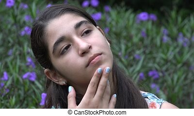 Teenage Girl Thinking at Garden - Teenage Girl Thinking at...