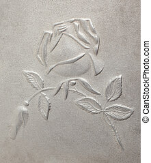 bas-relief depicting roses on the metal