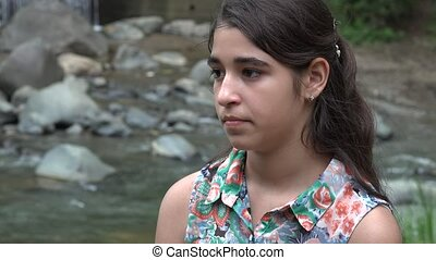 Solemn Teenage Girl at River