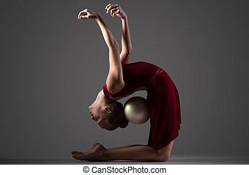 Gymnast girl bending backwards with ball - Beautiful cool...
