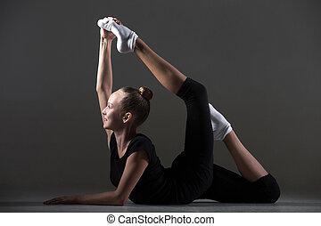 Girl doing backbend acrobatic exercise - Beautiful happy...