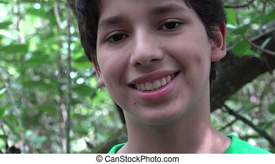 Teenage Boy Smiling in Forest