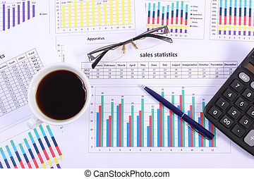 Pen, glasses, calculator and cup of coffee on financial...