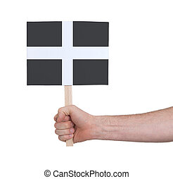 Hand holding small card - Flag of Cornwall