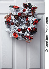 Christmas wreath - White front door decorated by Christmas...