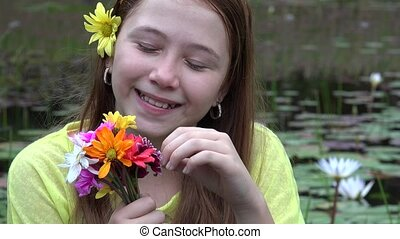 Happy Redheaded Girl with Flowers