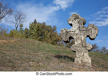 Old orthodox cross near the Cathedral of the Transfiguration...