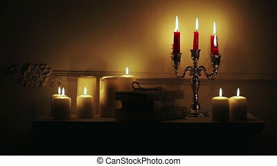 Old vintage books with candles in candlestick - Retro...