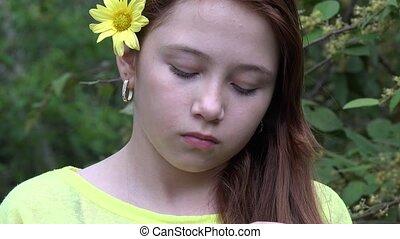 Sad Teen Girl near Trees