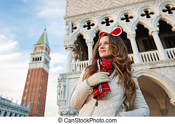 Young woman tourist spending Christmas holidays in Venice,...