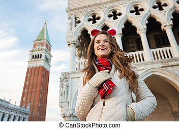 Happy woman tourist spending Christmas holidays in Venice,...