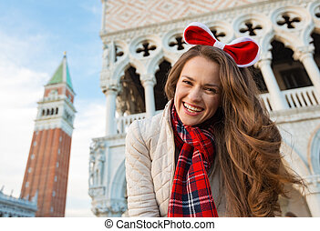 Woman tourist spending Christmas on Piazza San Marco in...