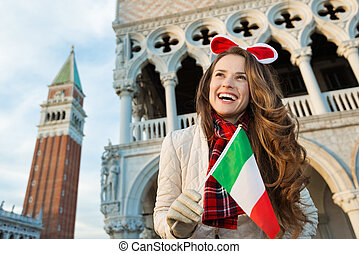 Woman tourist with Italian flag on Christmas in Venice,...